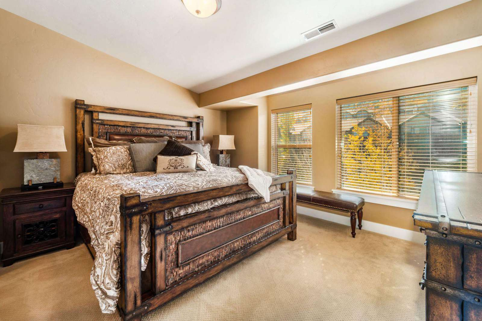 Master bedroom equipped with window views