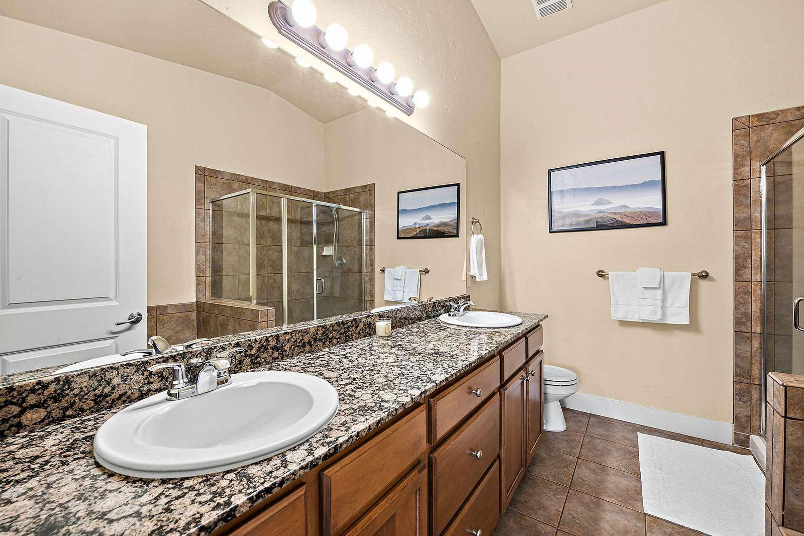 Master en-suite bathroom with two sinks
