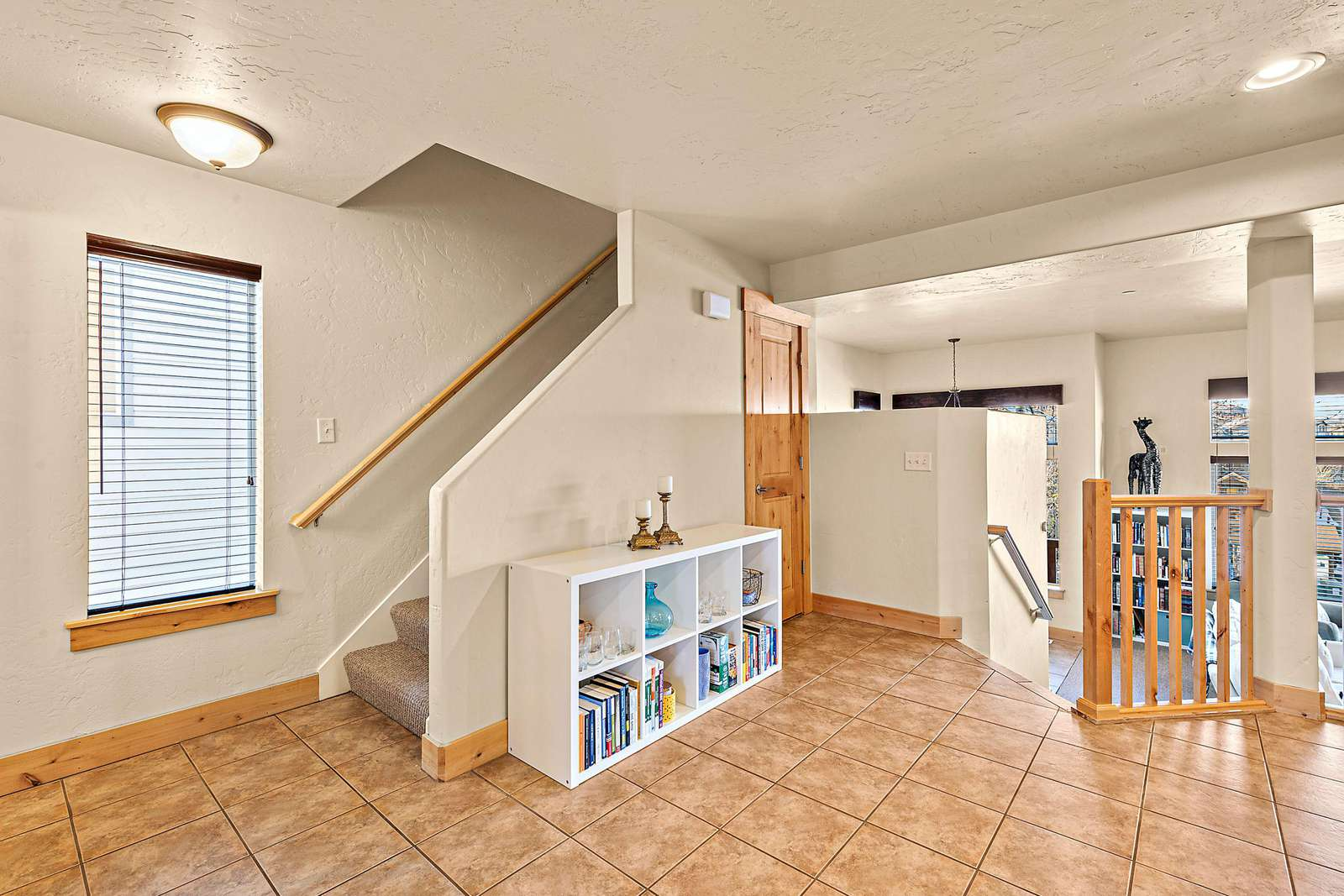 Staircase in kitchen area leading to top floor