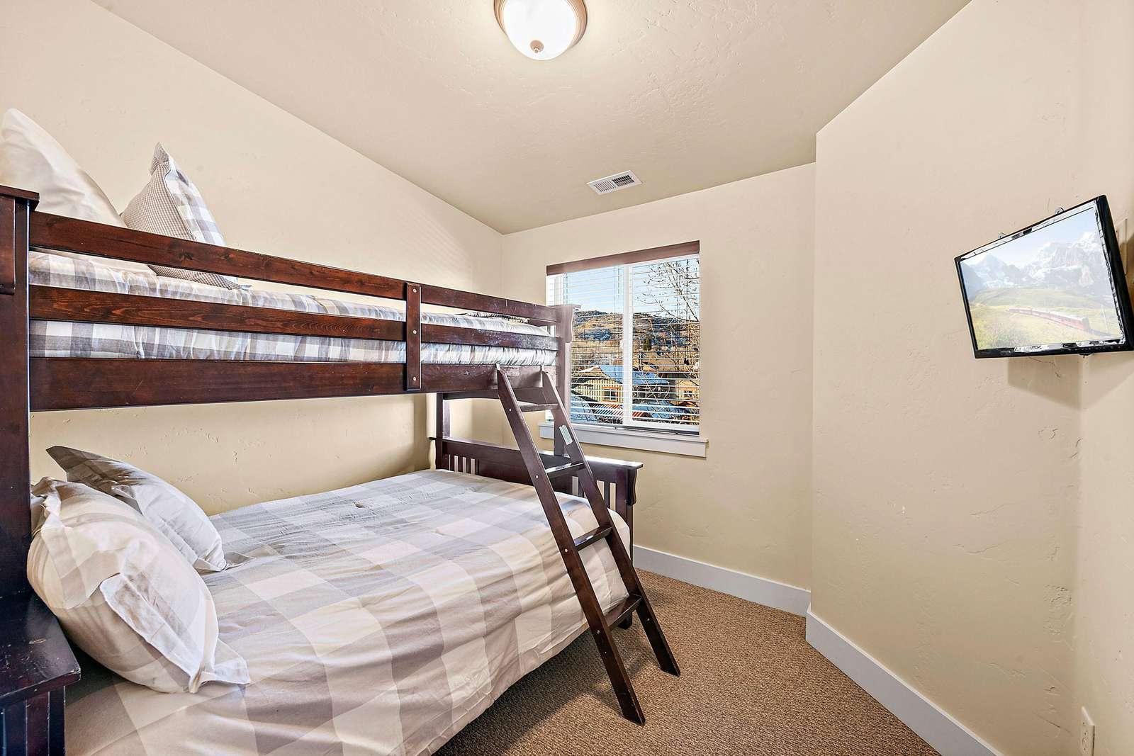Top floor guest bedroom with twin over full bunkbed