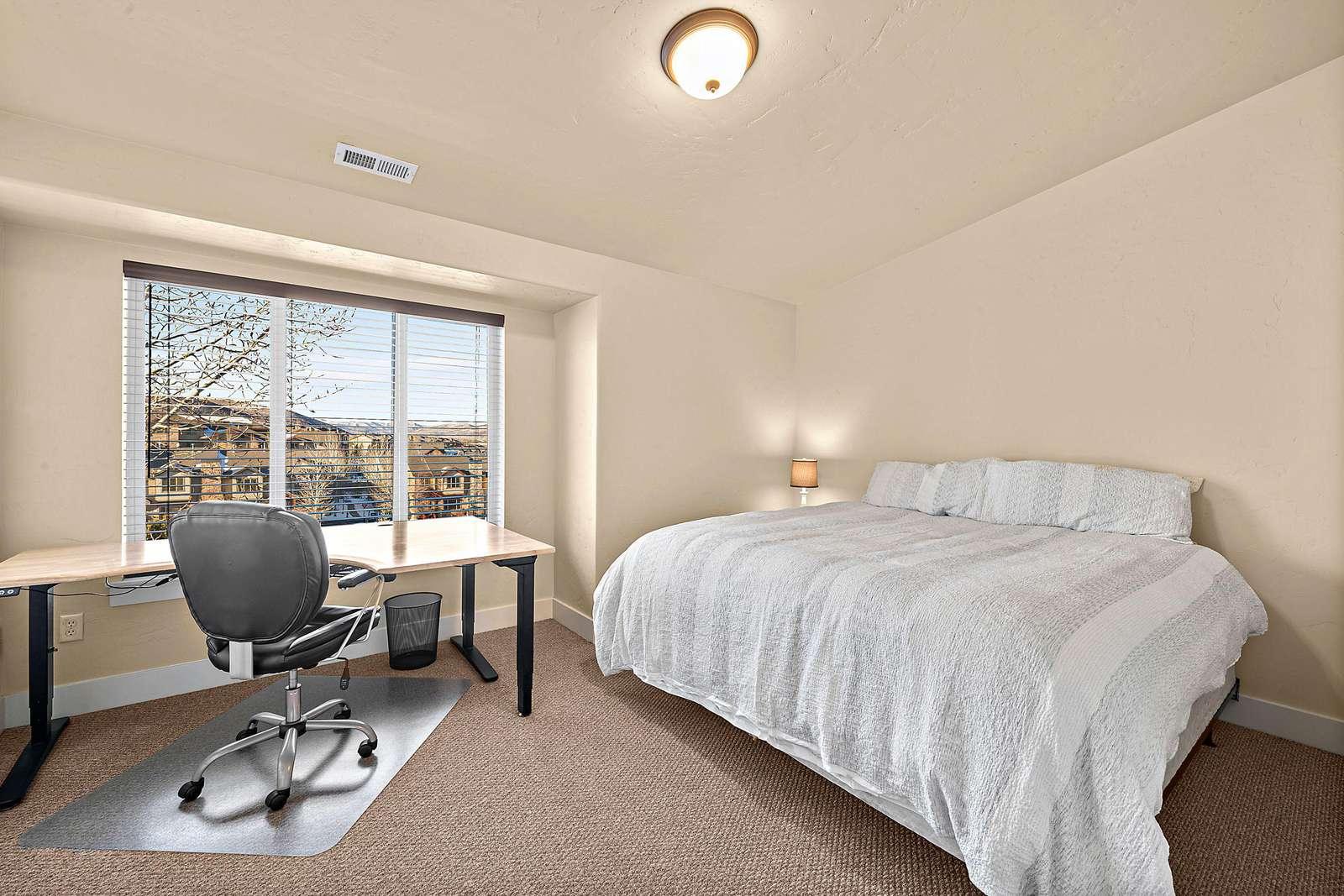 Top floor guest bedroom with large desk