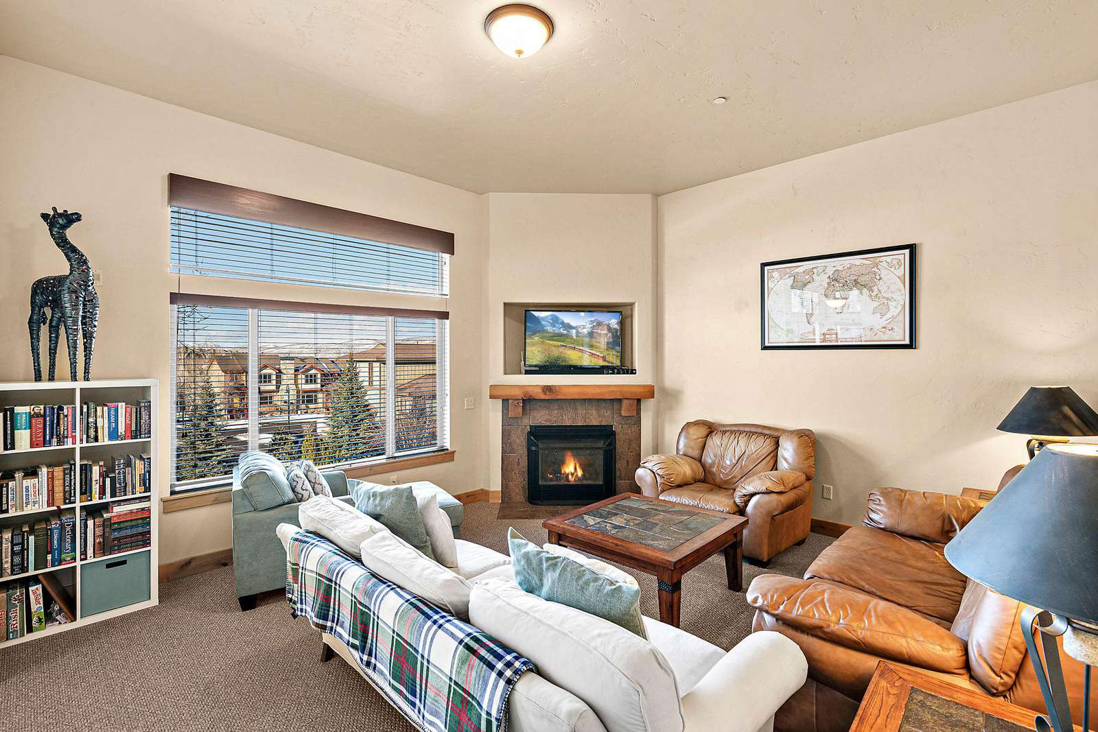 Open living area with TV and fireplace
