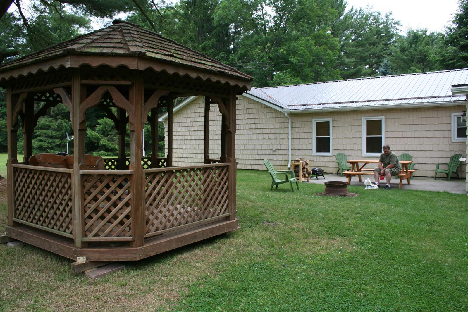 Back of cabin showing gazebo with glider
