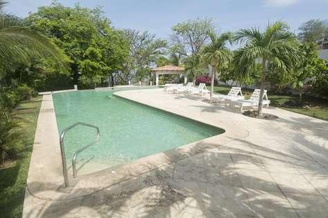 Community pool with ocean view